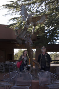Heather admiring one of John's many phenomenal bronze sculptures that highlight the  Sedona Creative Life Center.